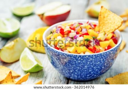 apple mango salsa on a white background wood. toning. selective Focus - stock photo