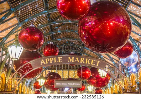 Apple market in Covent Garden in London NOV 16, 2014. The modern colorful Christmas lights attract and encourage people to the market. - stock photo