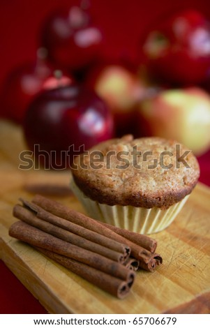 Apple muffin with butter and a glass with apple juice in background