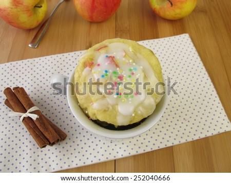 Apple mug cake with sugar icing from microwave  - stock photo