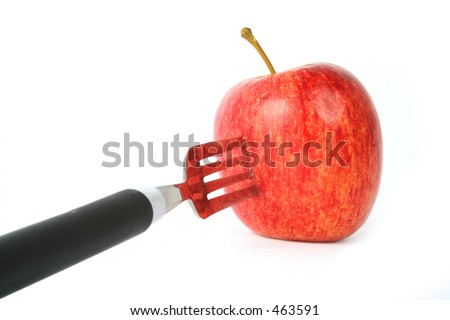 apple on a fork, perspective view - stock photo
