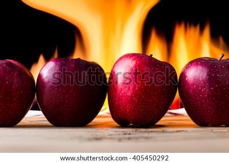 Apple on fire - stock photo