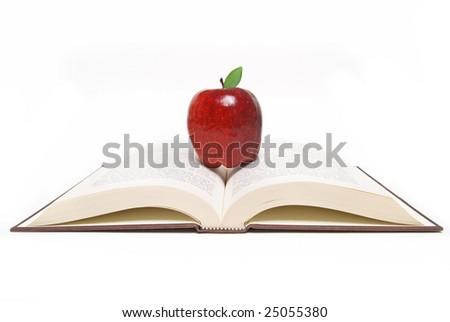 apple on open book - stock photo