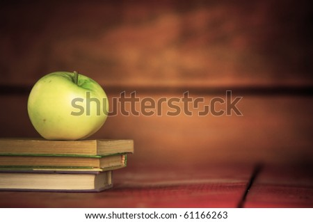 Apple on pile of books. Education concept, back to school. - stock photo