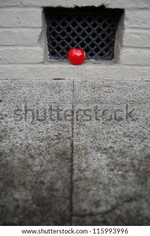 Apple on the Sidewalk - stock photo