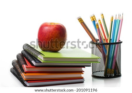 Apple on top colorful books isolated with white background