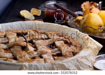 Apple/pear pie in a baking pan, with ingredients. - stock photo