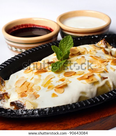 apple pie in vanilla frosting with sour cream and cherry jam on a white background - stock photo