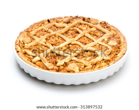 Apple pie in white ceramic pan on white background - stock photo