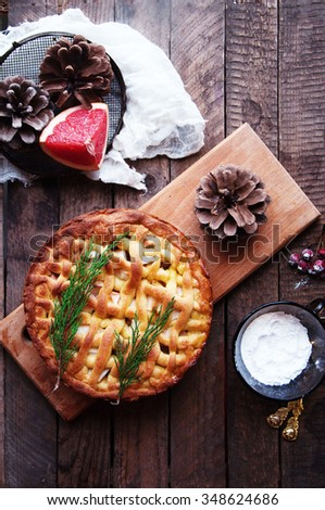 Apple pie  on vintage wooden background texture. Top view. Homemade apple pie, apples  on the wooden table. Rustic food style. - stock photo