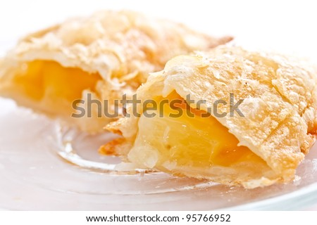 apple pie on white background presenting its filling - stock photo