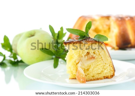 apple pie with apples and mint on a white background