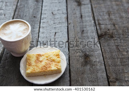 Apple pie with cup of coffee on wooden table - stock photo