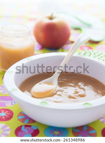 Apple puree for baby nutrition in bowl  - stock photo