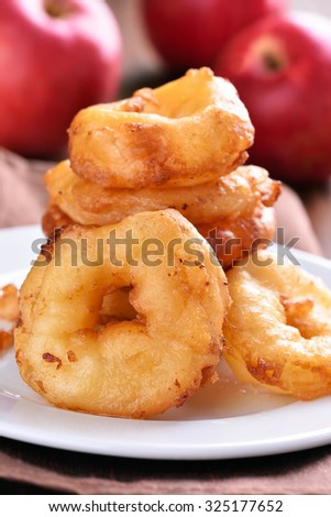 Apple rings on white plate, close up view