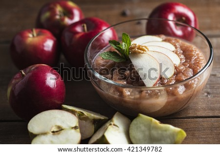 apple sauce on a clear bowl with slice of apple - stock photo