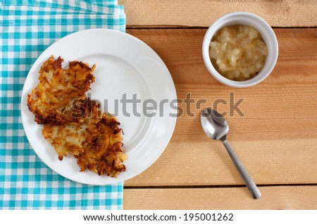 Apple sauce with latkes - stock photo