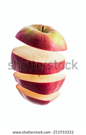 apple slices flying in the air - stock photo