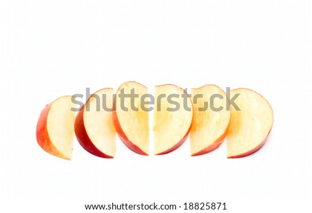 Apple slices isolated on white - stock photo