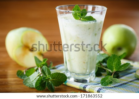 apple smoothie with mint on a wooden table - stock photo