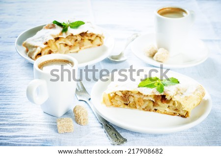 Apple strudel on a light blue background. tinting. selective focus on mint - stock photo