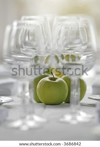 apple surrounded with wine glasses - stock photo