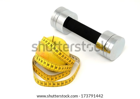 Apple, tape measure and dumbbell as symbol for healthy living