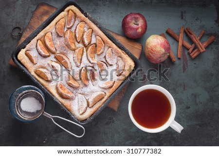 Apple Tart with tea. Puff pastry and cinnamon. With Copy Space - stock photo