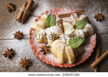 Apple tarts with spices and the powder sugar - stock photo