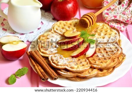 Apple waffles for breakfast. - stock photo