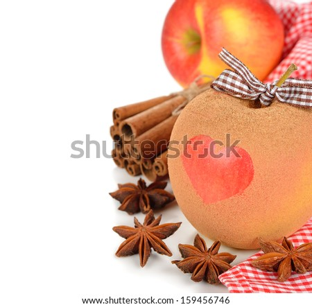 Apple with cinnamon and spices on a white background