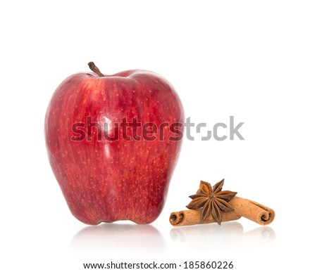 Apple with cinnamon on white