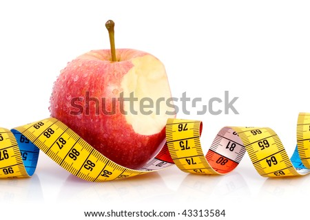 Apple with measuring tape - stock photo