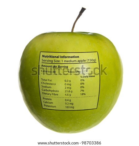 Apple with nutritional information stamped on it. (The values shown are an average of various sources - close to, but not the same as, any actual values). - stock photo