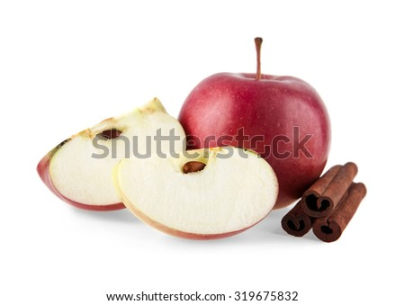 apples and cinnamon on a white background - stock photo