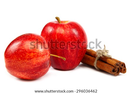 Apples and cinnamon sticks isolated on white background. - stock photo