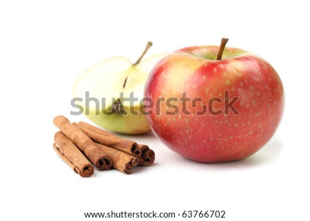 Apples and cinnamon sticks isolated on white background. Shallow dof - stock photo