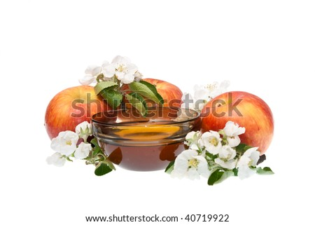 Apples and honey against white background - stock photo