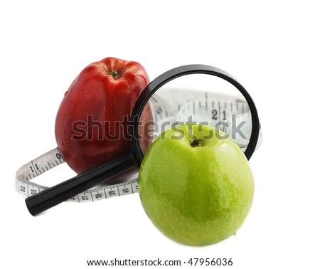 Apples and Magnifier isolated on white