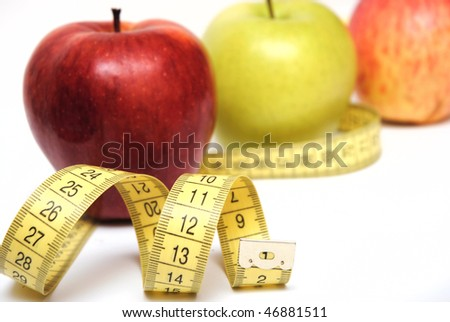 apples and measuring tape isolated on white