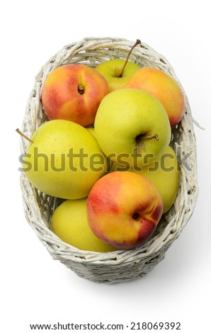 Apples and nectarines in a basket isolated on white background. Above view. - stock photo