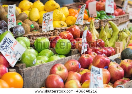 Apples and other fruits for sale at market.