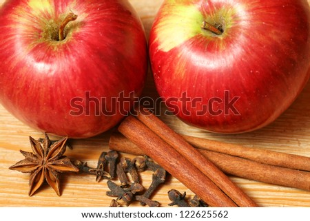 Apples and spices - two juicy fruits with cinnamon, cloves and star anise
