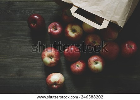 apples and the paper bag - stock photo