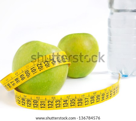 apples, bottle and meter on white background