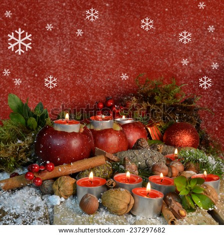 apples candles flames xmas card - nuts firs arbutus - snow  and red background - merry christmas - stock photo