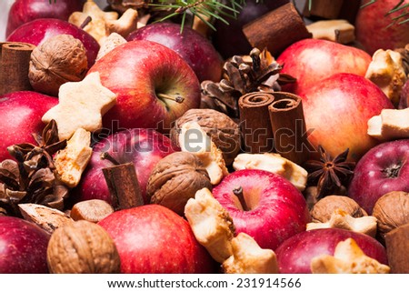 Apples, cones, nuts and cookies with spices. Aroma Christmas - stock photo