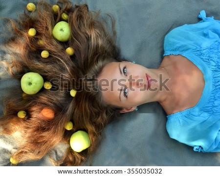 Apples,food in the hair,apples in the hair,vegetables in the hair,soft hair,fluffy hair,beautiful hair,brunette hair,natural hair,smooth hair,tasty hair,salon hair,straight hair,healthy,wellness hair - stock photo