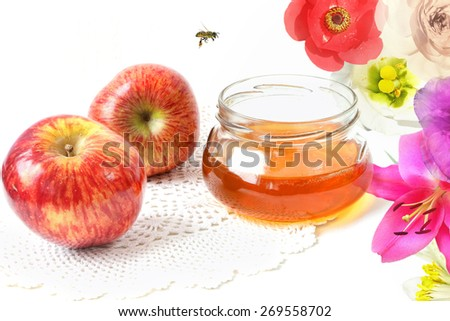 Apples, honey in the glass pot, bee. White background  - stock photo