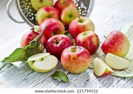 apples in a metal colander selective focus - stock photo